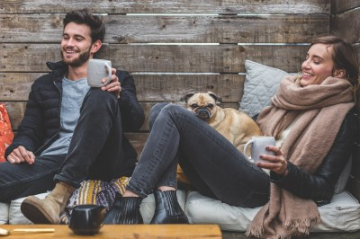 couple relaxing with their dog